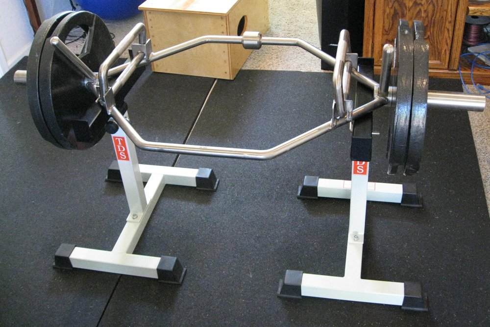 Loading plates on and off a trap bar for Homemade safety squat bar