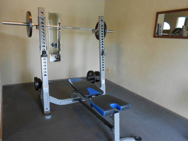 I Am Looking At A Nautilus Bench Press With A Squat Rack